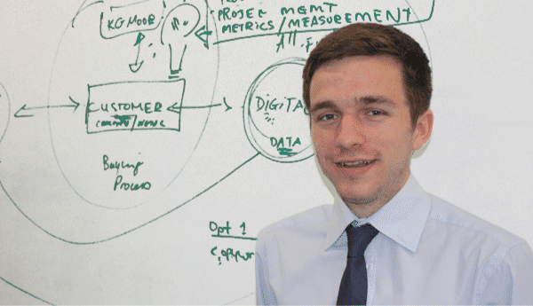 Oliver Hearsum in front of a whiteboard