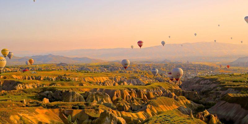 Air balloons over a valley
