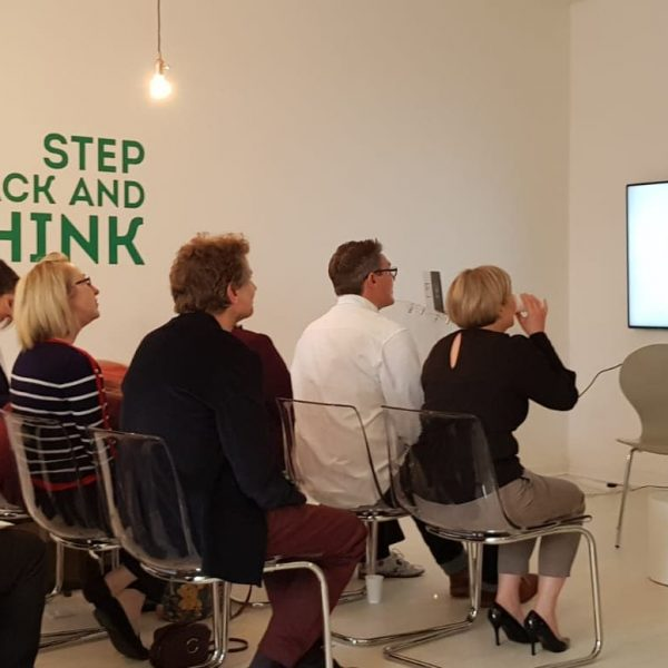 A group of people listening to Joe Glover at the Colchester Marketing Meetup