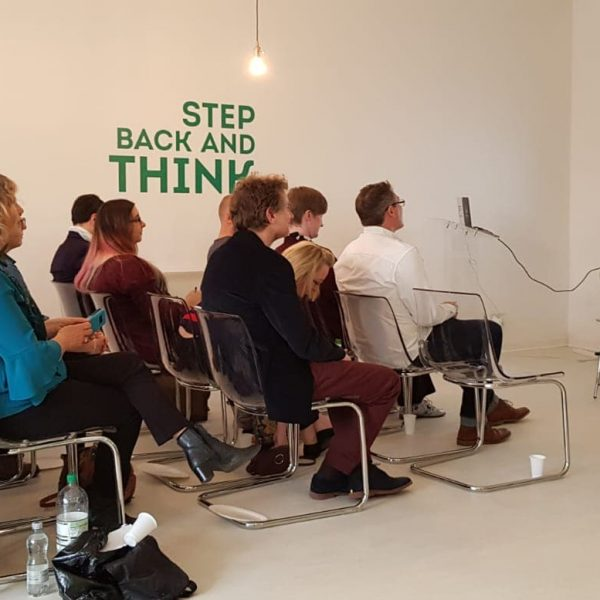 A group of people listening to a talk at the Colchester MarketingMeetup